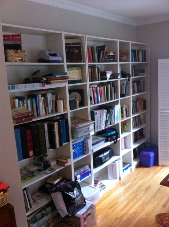 Bookcases in need of order.