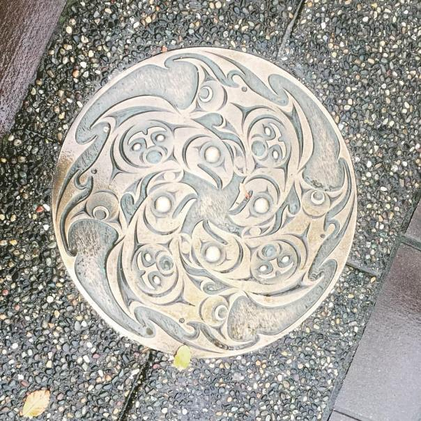 Medallion embedded in some Coal Harbour sidewalks.