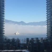 Marine fuel station emerging from fog.